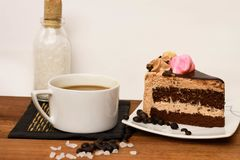 A cup of coffee with slice of chocolate cake Stock Photography