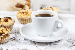 Cup of coffee and small cakes with dried fruit Stock Images