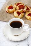 Cup of coffee and small cakes Stock Image
