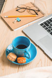 Cup of coffee and small cookies stock photography