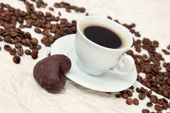 The cup of coffee and small gingerbread Royalty Free Stock Photo
