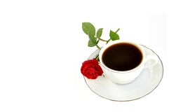 Cup of coffee and small red rose. Stock Photography