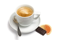 Cup of coffee, small spoon and sweets Stock Photos