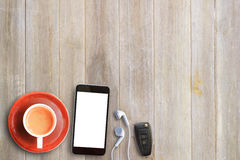 Cup of coffee,smart phone,ear phone and car key on wooden Stock Photos