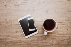 Cup of coffee, smart phone and tablet Royalty Free Stock Photography