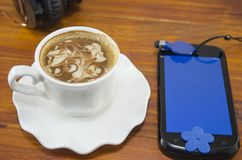 Cup of coffee and a smartphone Royalty Free Stock Images
