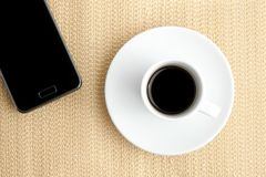 Cup of coffee with smartphone Stock Photography