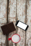 Cup of coffee with smartphone and organiser. On wooden table Stock Photo