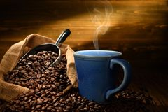 Cup of coffee with smoke on old wooden Royalty Free Stock Photography