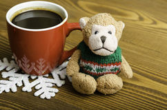 Cup of coffee, snowflake and toy monkey. Stock Images