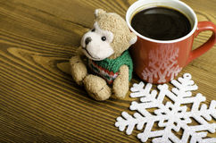 Cup of coffee, snowflake and toy monkey. Stock Photography