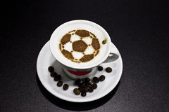 A cup of coffee with soccer ball Stock Photos