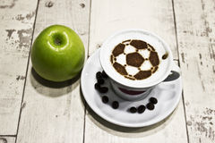 A cup of coffee with soccer ball Stock Photography
