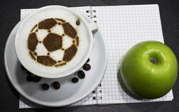 A cup of coffee with soccer ball Royalty Free Stock Image
