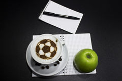 A cup of coffee with soccer ball Royalty Free Stock Images