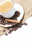 Cup of coffee and some cinnamon. Royalty Free Stock Images