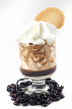 A cup of coffee with sour cream and a biscuit Royalty Free Stock Images