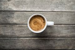 Cup of Coffee with soy milk on a wood table, top view stock photo