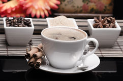 Cup of coffee, spices and coffee beans Stock Photos