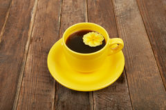 Cup of coffee with spices and flower on a wooden table backgroun Royalty Free Stock Images