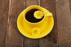 Cup of coffee with spices and flower on a wooden table backgroun Royalty Free Stock Photos