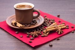Cup of Coffee with Spices on Red Napkin Royalty Free Stock Photo
