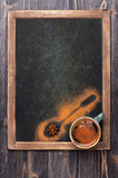 Cup of coffee with spices on vintage slate chalkboard. Menu board Royalty Free Stock Photos