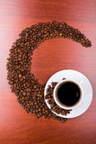 Cup of coffee and spilled grain Royalty Free Stock Images