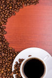 Cup of coffee and spilled grain Royalty Free Stock Image