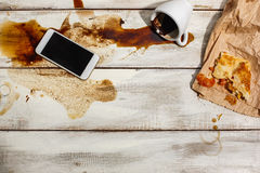 Cup of coffee spilled on wooden table Stock Images