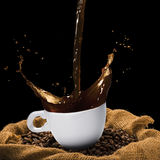 Cup of Coffee Splash Royalty Free Stock Images