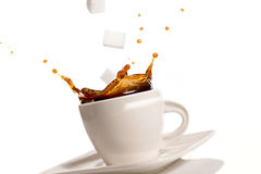 Cup of coffee splash Stock Images