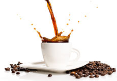 Cup of coffee splash Stock Image