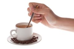 Cup of coffee with spoon Stock Images