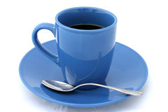 Cup of Coffee With Spoon. A blue cup filled with black coffee and a spoon on a white background royalty free stock photo
