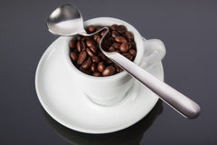 Cup of coffee with a spoon Stock Photos