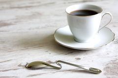 Cup of coffee with spoon abstract Stock Photo