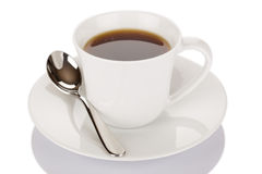 Cup of coffee and spoon Stock Images