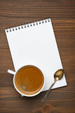 Cup of coffee, spoon and note pad, concept photo Stock Photo