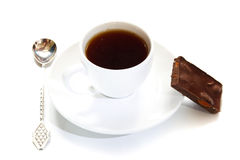 Cup of coffee, spoon, piece of chocolate Stock Image