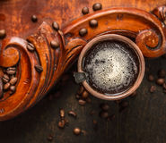 Cup of coffee with spoon and  on rustic wooden background with coffee beans Royalty Free Stock Image