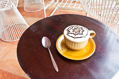 Cup of coffee with spoon on table Royalty Free Stock Photography