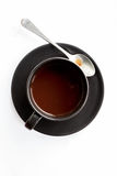Cup of coffee with spoon Stock Photos