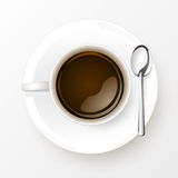 Cup of Coffee with spoon  on white background Royalty Free Stock Images