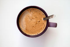 A cup of coffee. With a spoon on the white table Stock Photo