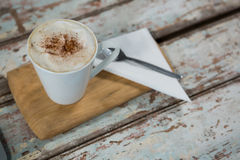 Cup of coffee and spoon on wooden tray Royalty Free Stock Photo