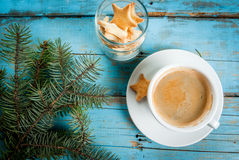 Cup of coffee with the sprigs of a christmas tree and cookies Stock Image