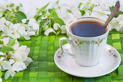 Cup of coffee with the sprigs of flowering Stock Photo