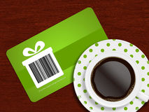 Cup of coffee with spring discount coupon lying on table Royalty Free Stock Photos