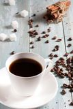 A cup of hot coffee with sugar and cinnamon Stock Images